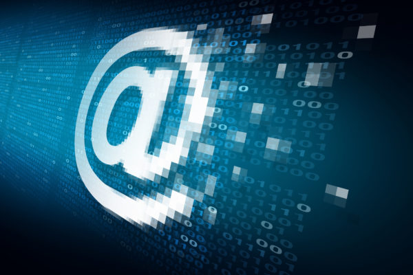 49949756 - email internet security technology concept as an at sign icon being encrypted for data transfer protection with binary code background as an online safety icon to protect password and username or reading of personal content.